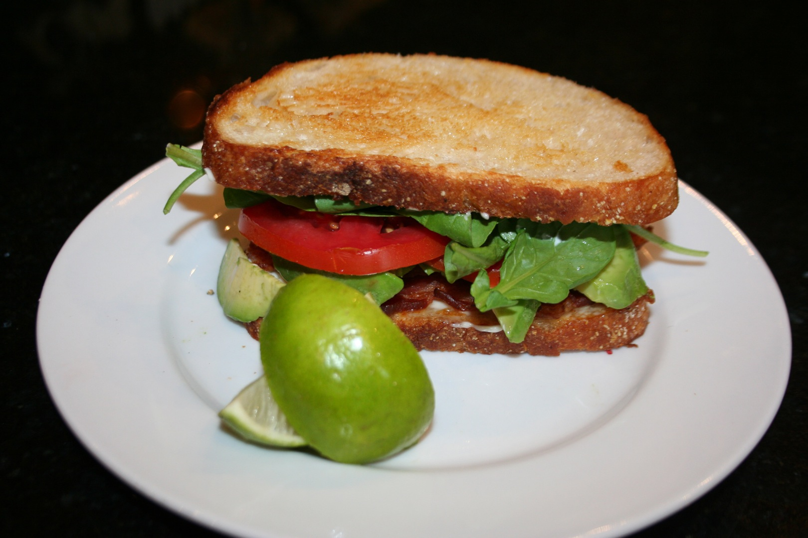 Avocado ~ BLT Sandwich with a squeeze of lime fresh arugula |